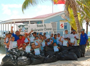 The group of over 15 kids embraced the clean up, Ambergris Property also gave a helping hand.
